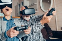 Grandma and grandpa having virtual reality equipment and playing three dimensional games